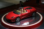 Production (Stock) Ferrari F430 Spider, 2006 Ferrari F430 Spider Base price: $195,100 (as tested, with F1 transmission, $204,867) Engine: 4.3-liter V-8, 483 hp/343 lb-ft Transmission: Six-speed electronically-shifted F1 manual transmission, rear-wheel drive Length x width x height: 177.6 x 75.7 x 48.6 in Wheelbase: 102.4 in Curb weight: 3351 lb Fuel economy (EPA city/hwy): 11/15 mpg (est.) Major standard features: Power windows, locks, and mirrors; power seats; AM/FM/CD; leather seats Warranty: Two years/unlimited miles