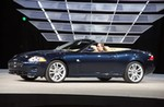 Production (Stock) Jaguar XK Convertible, Jag XK Gets $75K Pricetag  Just as Jaguar's new XK sports coupe gets ready to roll into showrooms, the automaker is adding a second model to the lineup. The convertible version features a three-layer ragtop that can operate in just 18 seconds. The XK convertible's aluminum chassis and body are not only lighter than the old sports car, but 50 percent stiffer. The automaker intends to bring the coupe to market for $75,500, officials announced on Monday, while the convertible will carry a $6,000 premium. So far, Jaguar claims to have received about 4000 'firm' advance orders for the next-generation XK.