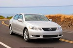 Production (Stock) Lexus GS450h, 2007 Lexus GS450h Base price: $58,000 (est.; GS430, $51,375) Engine: Hybrid Synergy Drive consisting of 3.5-liter all-aluminum V-6, 292 hp/267 lb-ft, and two electric motors generating a peak 197 hp. Combined rating is 339 hp Transmission: Continuously variable transmission with two-speed torque converter; manual mode simulated six-speed; rear-wheel drive Length x width x height: 190.0 x 71.7 x 56.1 in Wheelbase: 112.2 in Curb weight: 4134 lb Fuel economy (EPA city/hwy): 28/27 mpg (est.) Major standard features: Power windows, locks and mirrors; ventilated and heated leather power seats; AM/FM/six-disc, in-dash CD; rain-sensing wipers; moonroof; Park Assist; rear sunshade; headlight washers; remote keyfob and keyless start; adaptive suspension. Safety features: Dual front, side, and front and rear side-curtain airbags; rear backup camera; daytime running lights; anti-lock brakes; traction and stability control Warranty: Four years/50,000 miles; six years/70,000 miles drivetrain; eight years/100,000 miles hybrid components
