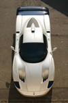 Production (Stock) Maserati MC12, Hard to peg this Maserati MC12. It?s assuredly one slick 630-hp fire breather, when it works the way it?s supposed to work. It?s related by DNA to the Enzo Ferrari supercar, but the MC12 is rarer by a factor of seven, and it?s no floor lamp. The MC12 is the first factory race car in nearly 50 years from one of the most successful racing marques ever. In the United States, even if you are one of the handful with commitment and a pile of cash large enough to try, you might not be able to import one. An exotic enigma, in some respects a refugee, the MC12 is nonetheless more charming and more intriguing than an Enzo or a Porsche Carrera GT. It?s also cooler.