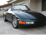 Production (Custom) Porsche 911, My most recent 911 project.Trouble is I'm getting burnt out on air cooled vehicles.I always wanted a cabriolet so I butchered up a targa.2.7,Weber's,E cams ,Bursch sport exhaust,S heads,lowered,suspension mods,better brakes,and really lightened up.Custom modified fiberglass C-2 bumpers with modified 928 S-4 headlights really cut off some pounds.The color is stock Porsche Amazon Green Pearl Mettallic.