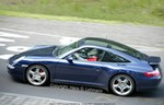 Production (Stock) Porsche 911, Here are latest photos of Porsche's upcoming top of the line model, the new 911 Turbo and the Targa-version. The very minor disguise has been removed by computer in order to show the two prototypes in full showroom trim.