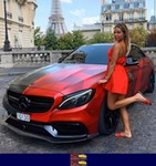 Women Mercedes-Benz Unknown (M-B), a person in a red car in front of a building