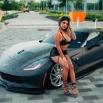 Women Chevrolet Corvette, a woman sitting in a car posing for the camera